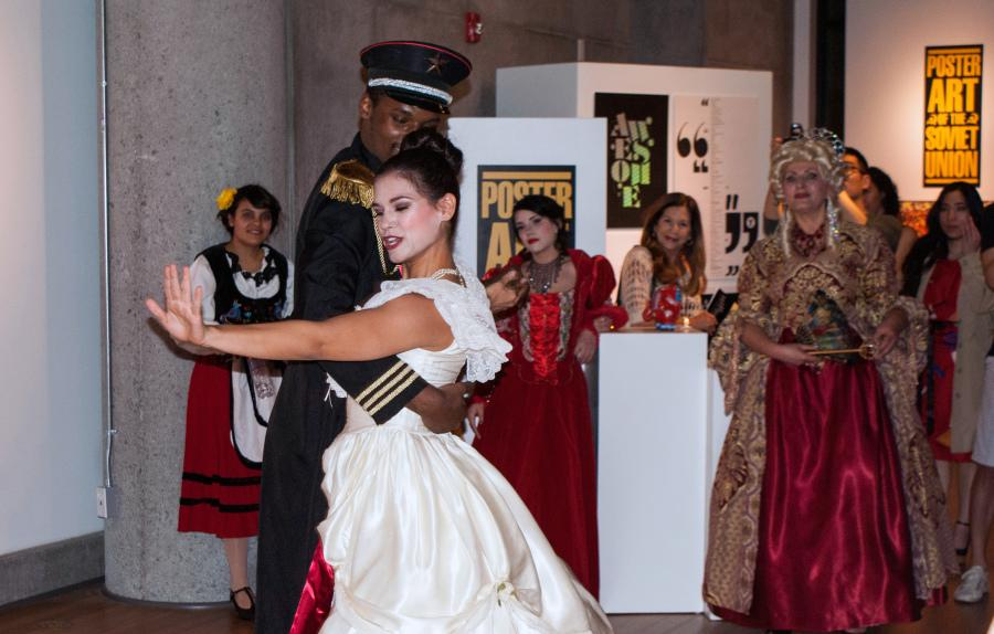 "City College dancers Dante Finch and Brianna Bellamy perform a traditional Russian waltz in the center of the City Gallery as part of the opening reception for the gallery's newest exhibition, ""Dialogues: Poster Art of the Soviet Union,"" on March 13. Photo credit: Torrey Spoerer"