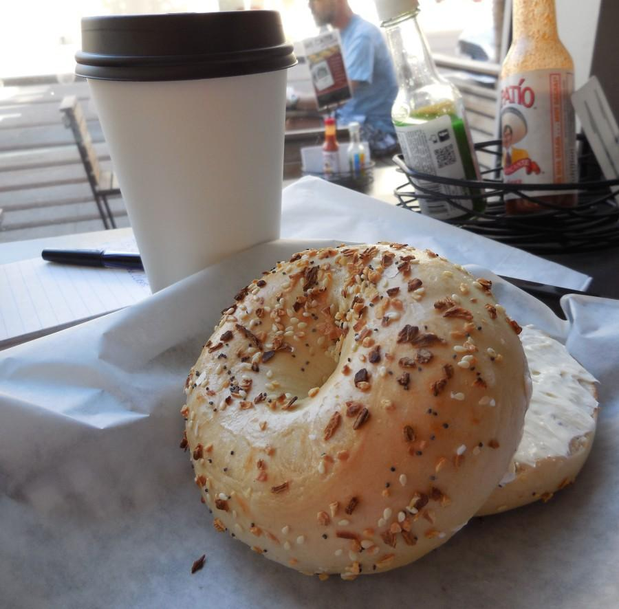 An+everything+bagel+with+plain+shmear+and+a+large+Caf%C3%A9+Moto+Fillip+Rally+coffee+is+one+of+the+many+choices+at+Brooklyn+Bagel+%26+Bialy.+Photo+credit%3A+Phoenix+Webb