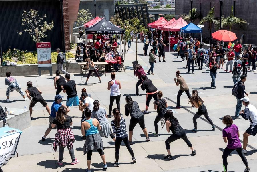 Attendees of San Diego City College's 2nd Annual Community Open House participate in a kickboxing class on the AH/BT quad on April 15. Photo credit: Joe Kendall