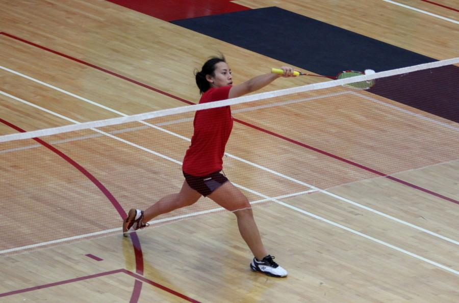Sophomore Gina Niph reaches for the birdie during the second round of the doubles match against Mesa College on April 22 at the Harry West Gym. The Knights went on to win, 17-4 and clinched their fourth straight PCAC title. Photo credit: David Pradel