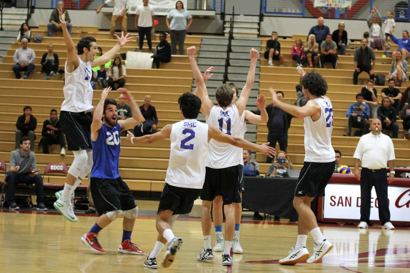 The Santa Monica men's volleyball team celebrating their championship victory as the final whistle blew at the Harry West Gym on April 25. Photo Credit: David Pradel