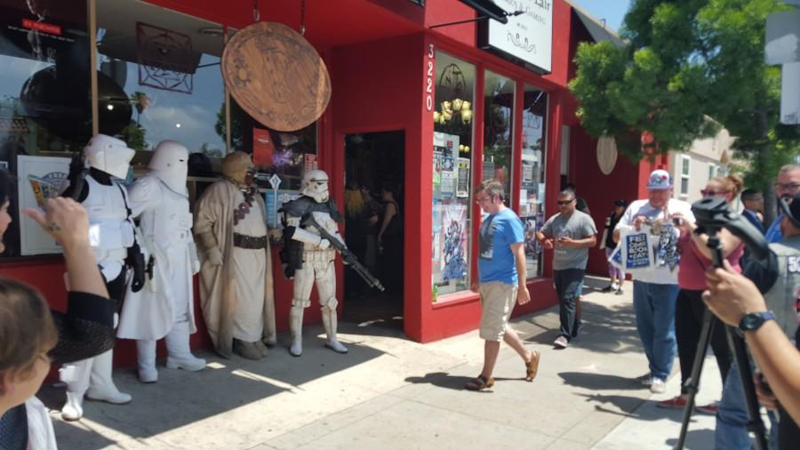 Fans, photographers and various Star Wars characters line the entrance to Villainous Lair Comics & Gaming on Adams Avenue during Free Comic Book Day on May 2. Photo credit: Antonio Marquez