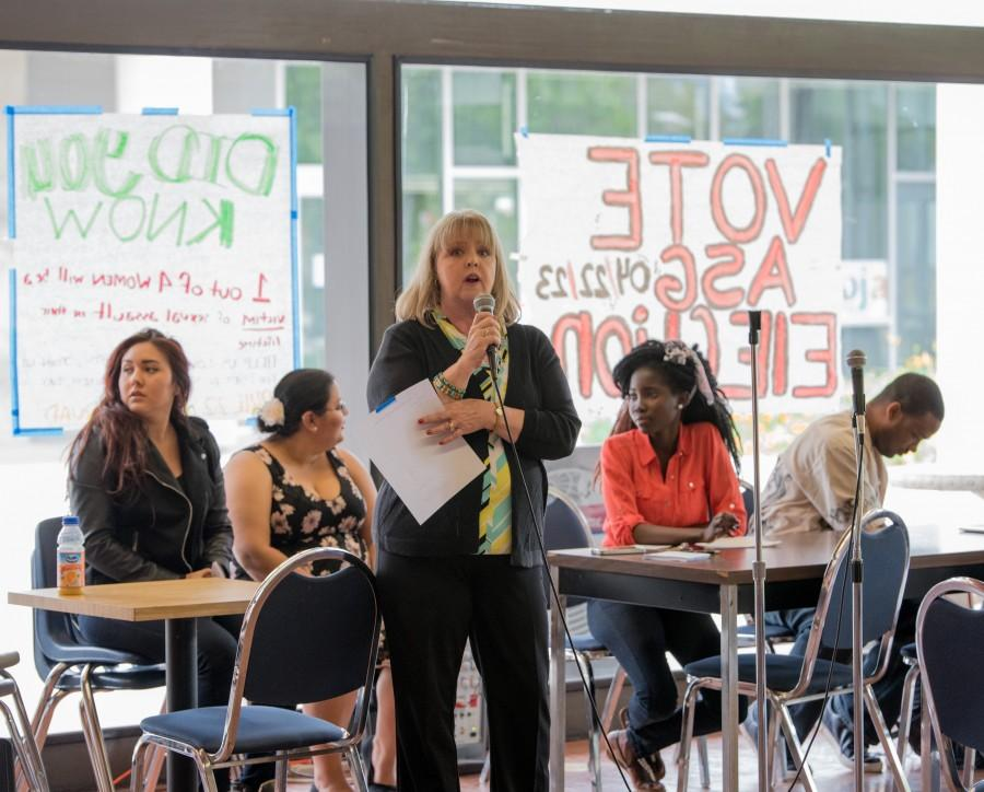 Student Affiars Coordinator Lori Oldham addresses a crowd gathered in the cafeteria for the 2015 ASG election forum on April 21, where candidates answered students' questions and concerns. Photo credit: Joe Kendall