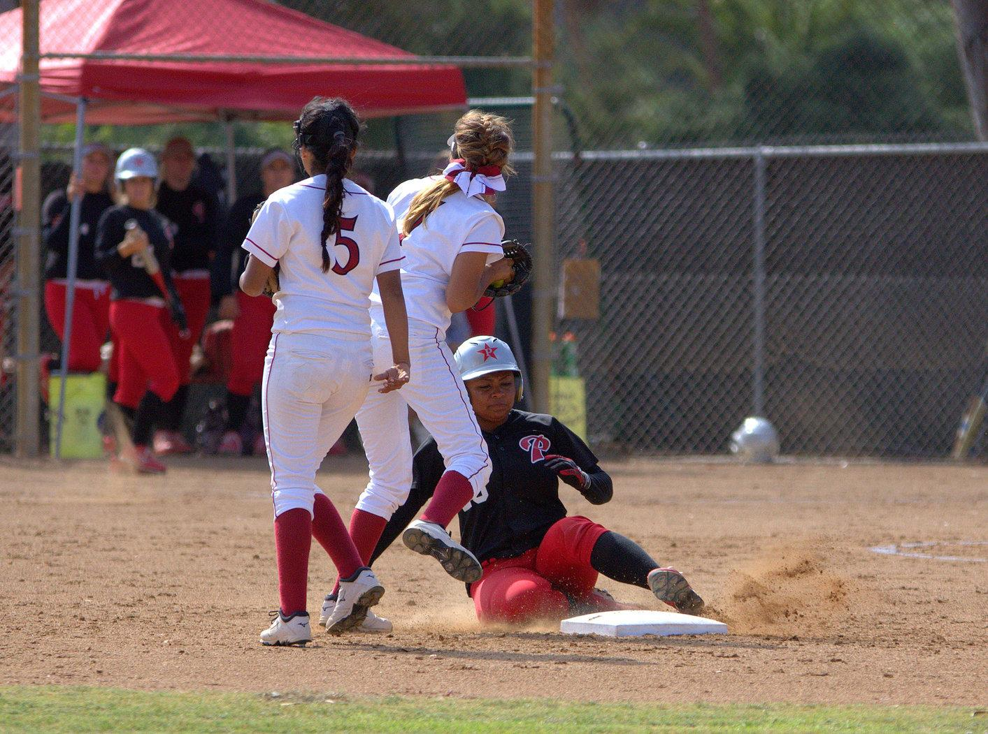 Palomar College freshman third baseman Iesha Hill slides to second base during the fourth inning at the Betty Hock Softball Field on April 21 where the Comets got the 14-0 victory against the Knights. Photo credit: David Pradel