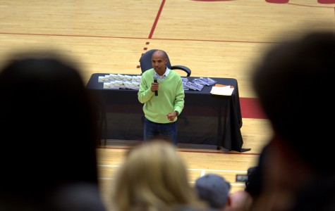 2014 Boston Marathon winner,  Meb Keflezighi tells the story of when he first started running in junior high on May 7 at the Harry West Gym. Photo credit: David Pradel