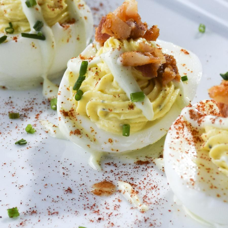 S%26M%E2%80%99s+deviled+eggs+may+look+like+typical+picnic+fare%2C+but+the+wasabi+aioli+and+the+spicy-sweet+combination+of+honey+Sriracha+bacon+make+this+appetizer+stand+out+from+the+pack.+Photo+credit%3A+Lauren+J.+Mapp