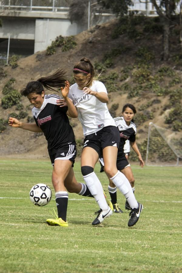 Knight freshman midfielder Annalais Oswald gets controls of the ball cutting vikings' Viking freshman forward Savannah Christensen's kickback. Photo credit: Celia Jimenez