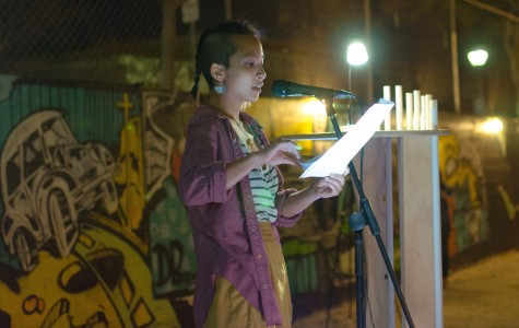 "A VAMP participant reads her ""taking a stand"" inspired monologue during the VAMP showcase on March 26. City Times archive. Photo credit: Richard Lomibao"