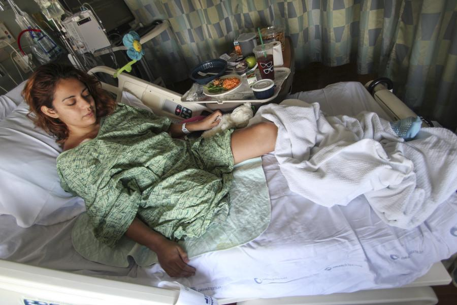San Diego City College student Zaphire Alonso lays in her hospital bed at UCSD Medical Center on Sept. 9 after transferring from Hospital General de Playa del Carmen in Cancun, Mexico, after an Aug. 16 motorcycle accident. Photo credit: Mike Madriaga