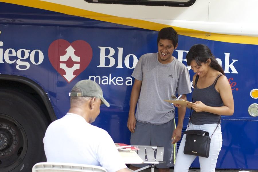 Potential donors Maria Victoriano (right) and Louis Resendiz (left) discuss San Diego Blood Bank application with volunteer James Ward on Sept. 11. Photo credit: Ricardo Soltero