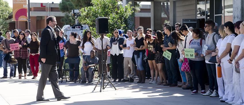 San Diego City College President Anthony Beebe addresses a crowd of students, faculty and staff in Gorton Quad on Oct. 8 before a moment of silence for victims of the Umpqua Community College shooting in Oregon. Photo by Susan Lee, Contributor