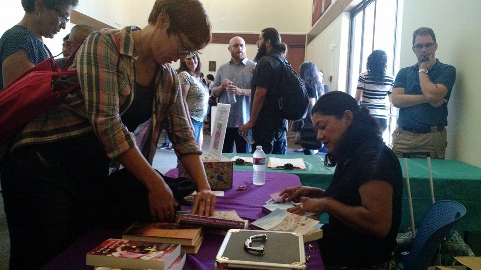 "Author Reyna Grande (right) signs copies of her book ""The Distance Between Us: A Memoir"" during the 10th annual San Diego City College International Book Fair on Oct. 13 in the Saville Theatre on campus.   Official Facebook photo."