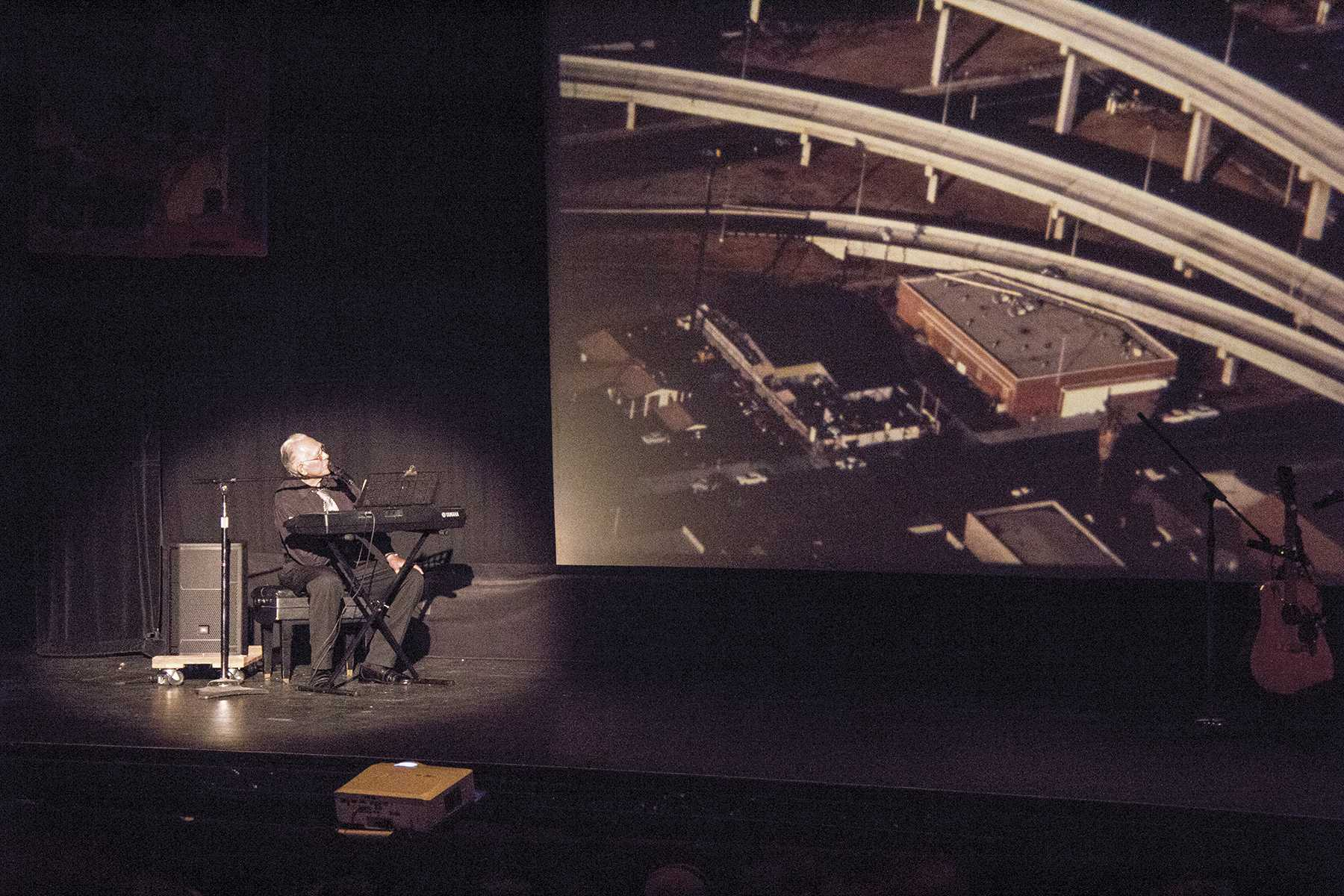 San Diego City College alumnus and local artist Salvador Torres engages audience members with a retelling of the Chicano movement as art history to a packed house in the Saville Theatre on Oct. 8. Photo credit: Celia Jimenez