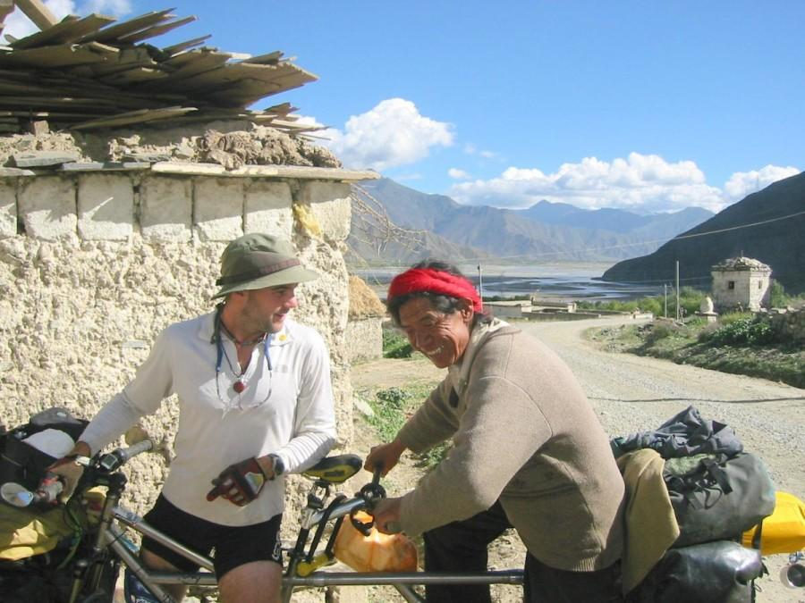 Jamie Bianchini and a passenger share a ride on his tandem bicycle in Tibet during his adventure that covered 81 countries. Photo from Abicyclebuiltfortwobillion.com