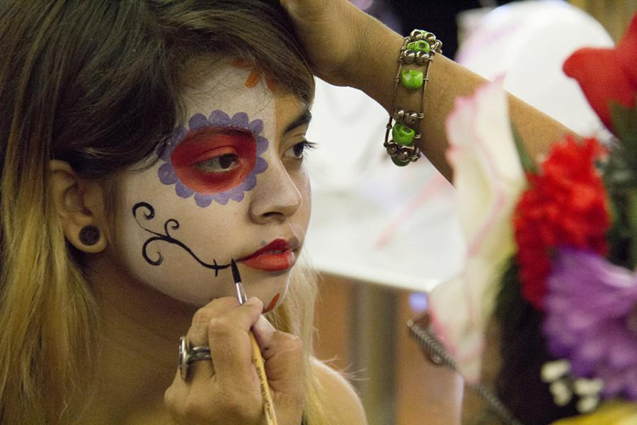 Students had the opportunity to get their faces painted in the cafeteria for the Day of the Dead celebration on Oct. 29. Photo credit: Celia Jimenez
