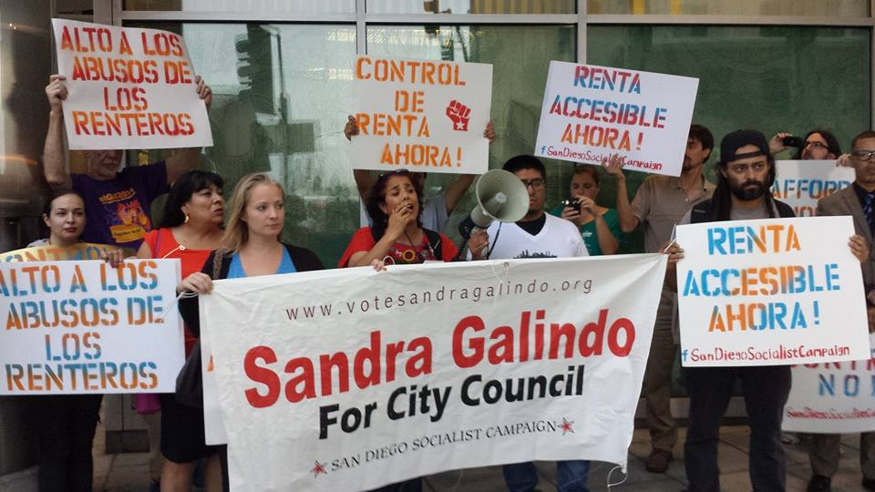 Surrounded by protesters and campaign supporters from the San Diego Socialist Campaign, Sandra Galindo (center) speaks at a renters rights rally on Sept. 21 in City Heights.    Official Facebook photo