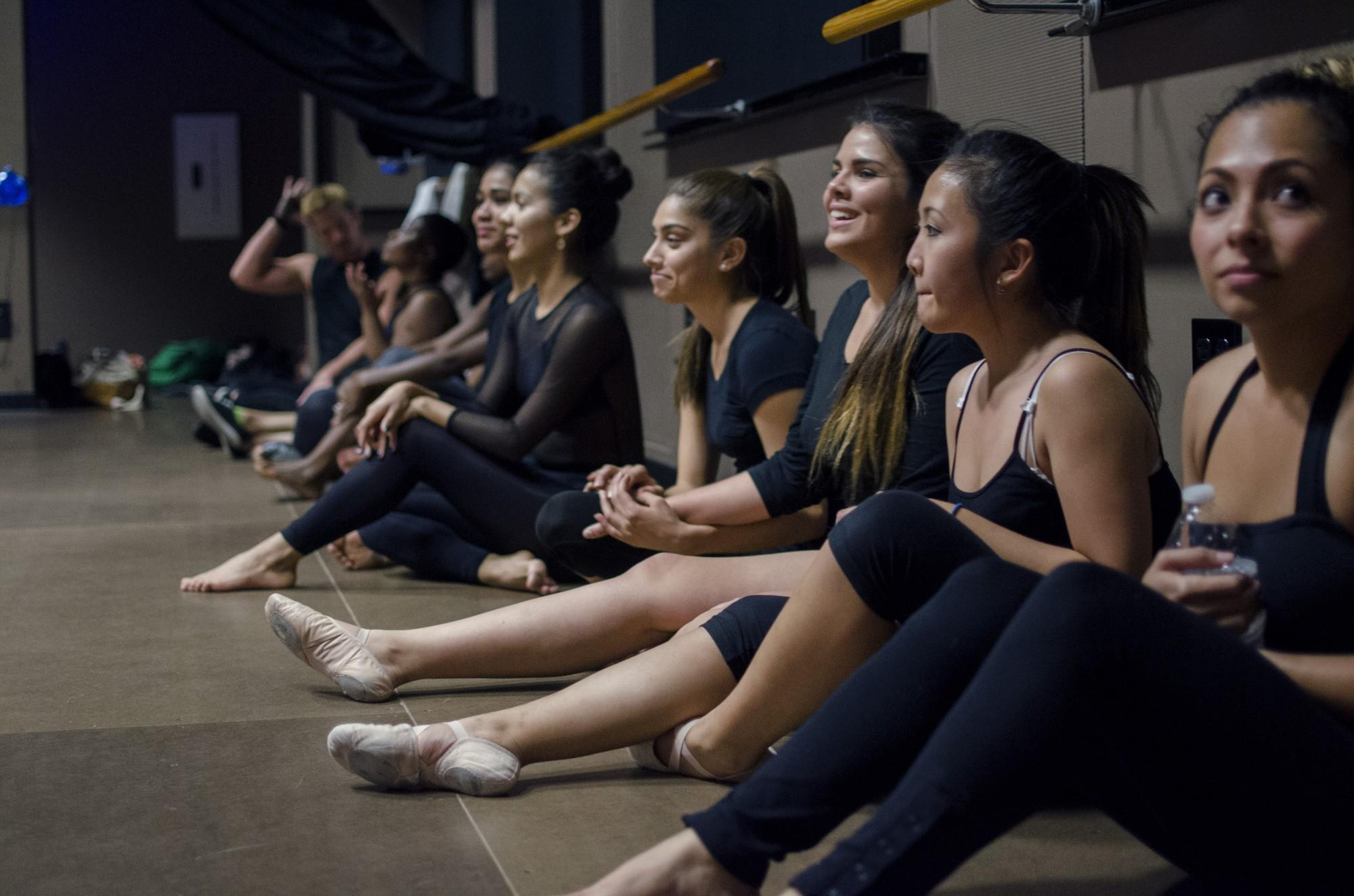 "Students gather in the Black Box Theatre to audition for the 2014 production of the ""City Moves"" dance concert. Photo credit: Richard Lomibao"