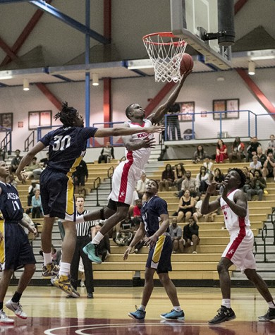 The Knights basketball team win Pacific Athletic Coast Conference  championship two games before the end of the season defeating Mesa College Olympians 94-82 at City College West Gymnasium on Feb. 12. Photo credit: Celia Jimenez