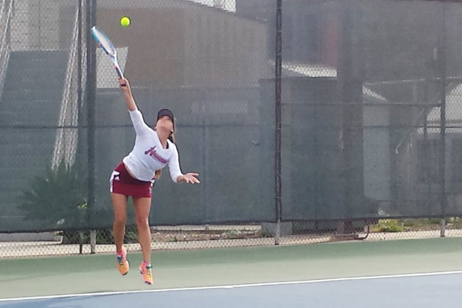 Freshman+Palia+Griffin%2C+the+team%E2%80%99s+number+one+singles+player%2C+swept+the+first+set+7-0.+Photo+credit%3A++Michael+Markulin