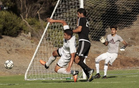 Tartars sophomore  midfielder  Adrian Guzman  and Knights  freshman midfield Gerardo  Lopez  battle over the ball near  Knights'  goal on Sept.  8  at  the San  Diego  City College  soccer field .Photo credit: Celia Jimenez