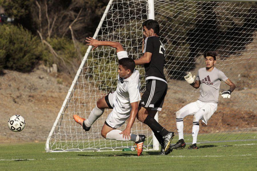 Tartars sophomore  midfielder  Adrian Guzman  and Knights  freshman midfield Gerardo  Lopez  battle over the ball near  Knights'  goal on Sept.  8  at  the San  Diego  City College  soccer field .Photo credit: Celia Jimenez