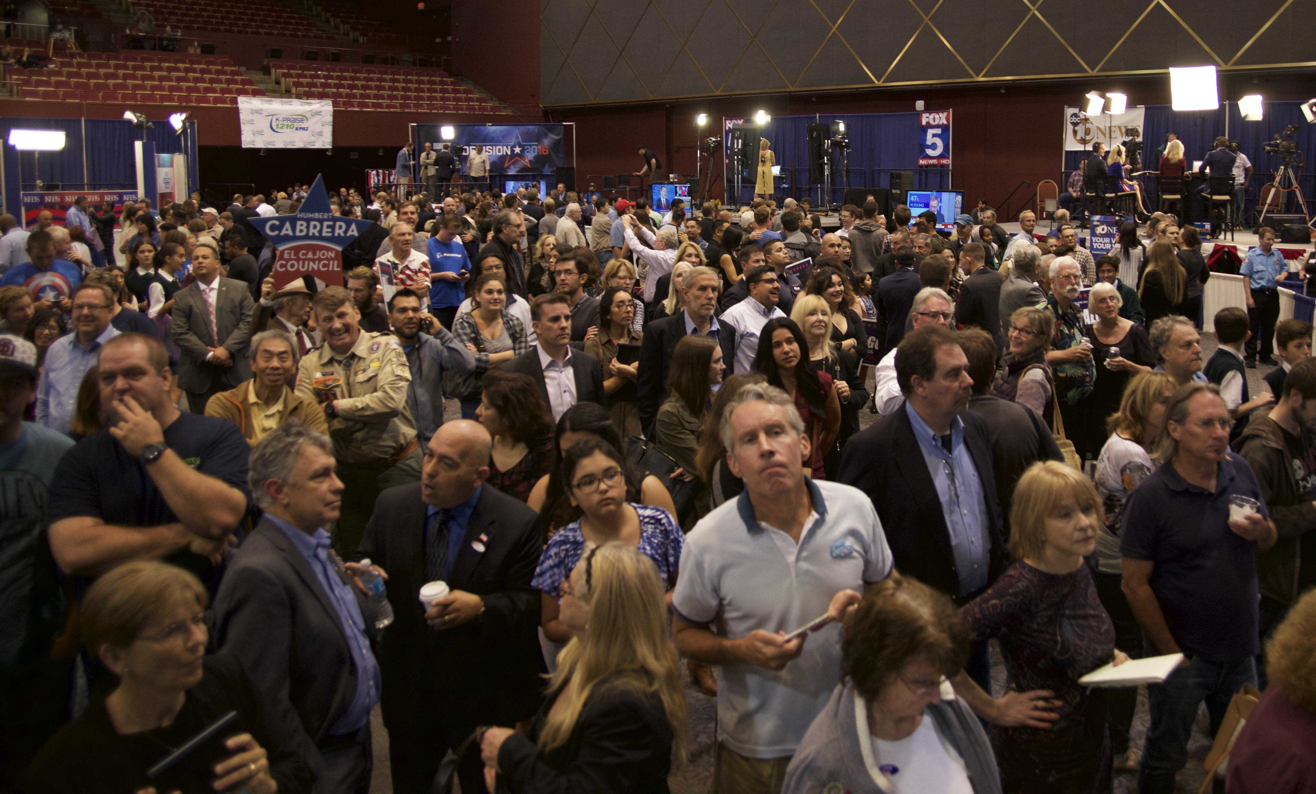 Spectators watching U.S. election results at Golden Hall in downtown San Diego. Nov. 8. Photo credit: Thomas Chesy