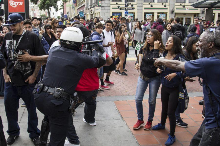 A San Diego police officer clashes with a young man during a march Nov. 16 through downtown streets to protest the election of Donald Trump as president.