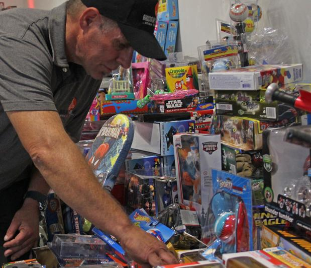Robert Crouse, a former City College student, helped to gather over 4,000 new toys and clothing articles to donate.