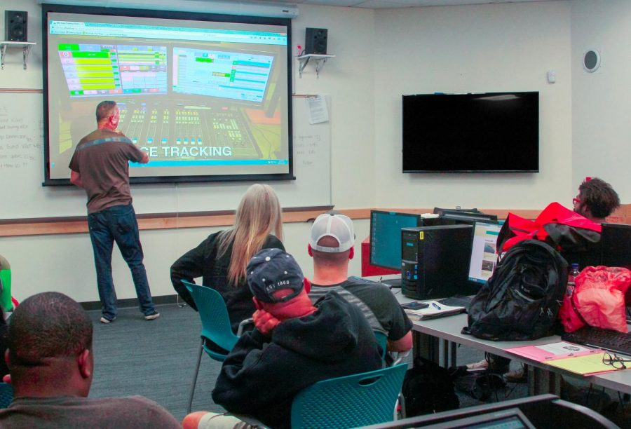 Professor Dave Smith during lecture discussing voice tracking to his students in the the Advanced Radio Production class in preparation for their radio show, San Diego City College, Oct.18, 2017.
