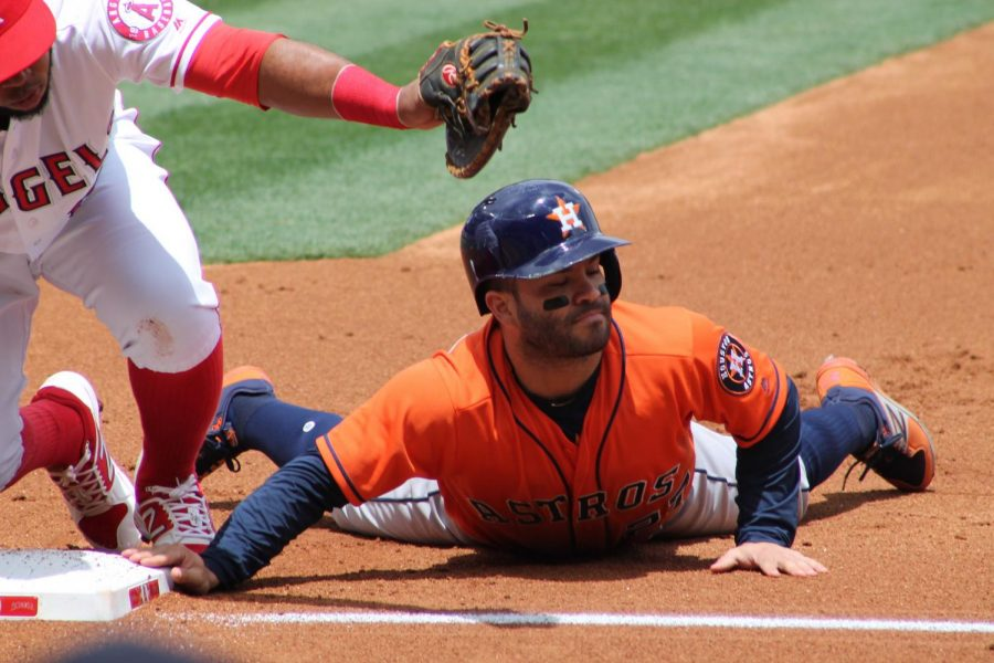 Houston Astros player Jose Altuve tagged out at first base during a Angels vs Astros game in at Angel Stadium, May 2017.