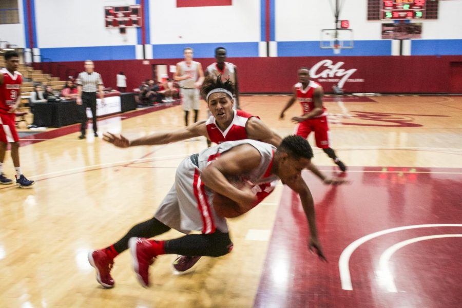 City College's sophomore guard, Deion Davis #11, runs across a staggering pass against Imperial Valley's Team