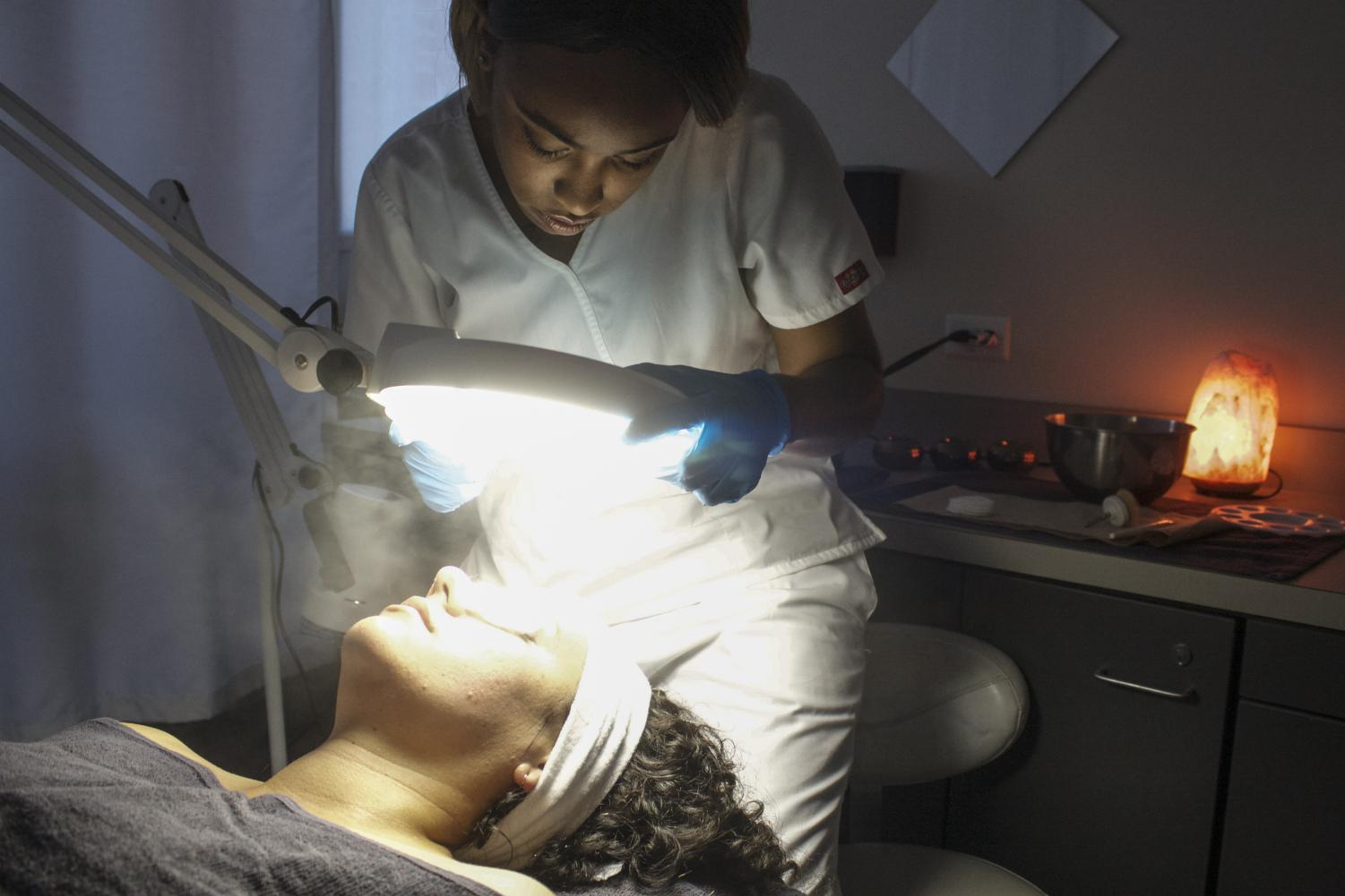 Kameal Thomas provides skin treatments as part of a hands-on esthetics program.