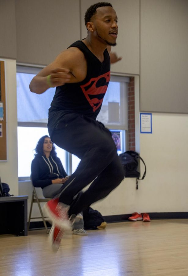 D'Marcus Andrus showcases to his fellow classmates his airborne dance skills.
