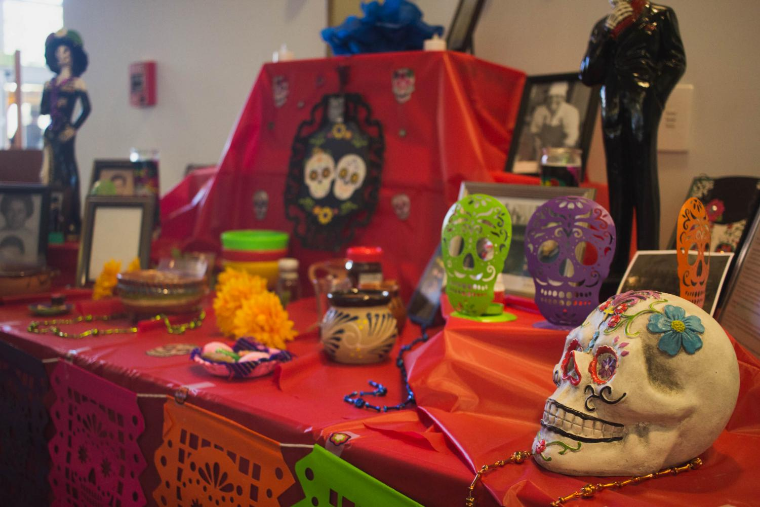 The staff of the Learning Resource Center have a Dia de los Muertos altar set up near the LRC entrance on the second floor of the R building. Photo by Nadia Mishkin, City Times.