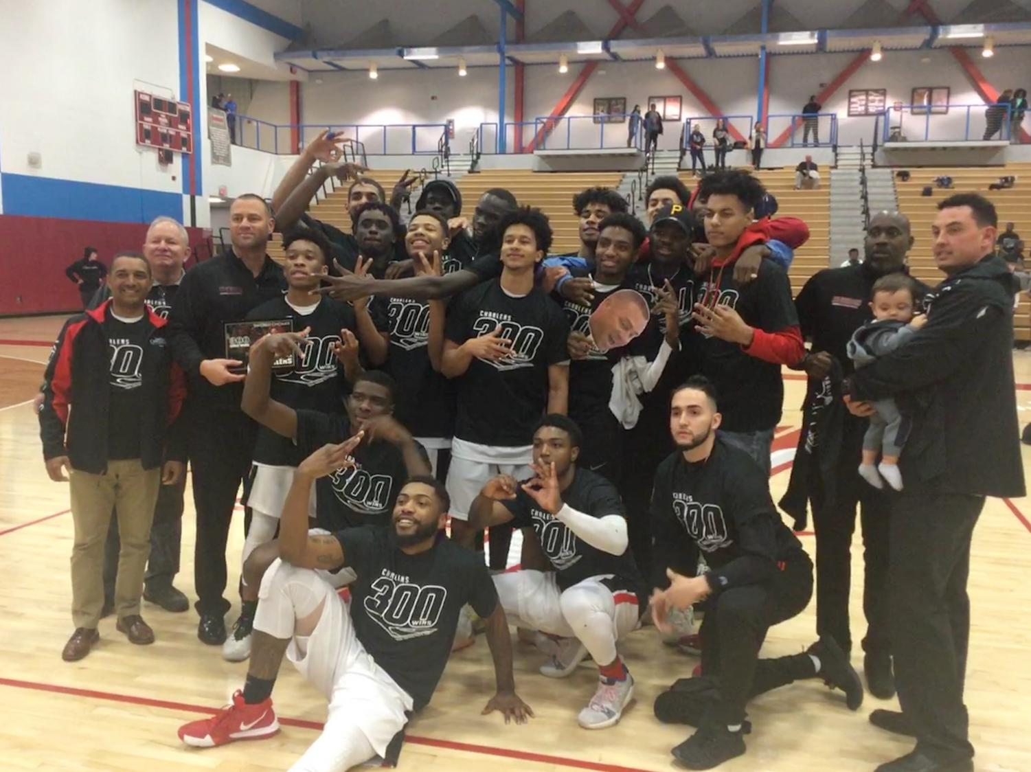 The City College men's basketball team celebrates after coach Mitch Charlens' 300th win. By Sonny Garibay/City Times