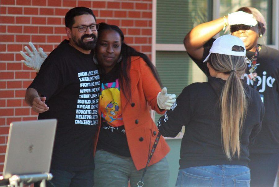 Dr. Rob receives a hug from Math Jam volunteer