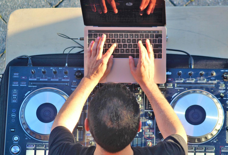 Dr. Rob Rubalcaba mixed popular hip-hop songs at the Math Jam tutoring event. By Jonny Rico/City Times