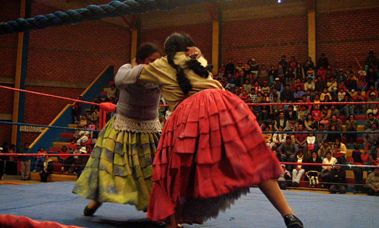 Female wrestlers in Bolivia have a bigger battle outside of the ring. Photo courtesy Mamachas del Ring