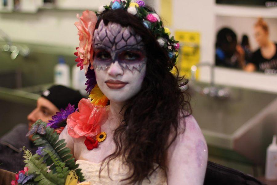 Mesa College psychology student Leslie Barreras modeled artist Tracy Castrejon's Mother Earth design.