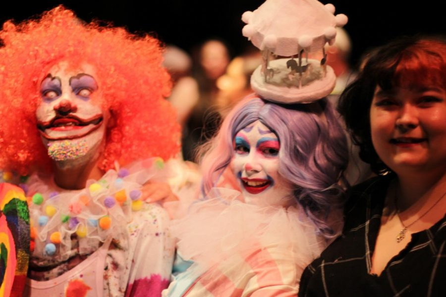 Eddie Loya and Carly Stacey as candy-colored clowns pictured with the artist, Meerji Byrom.