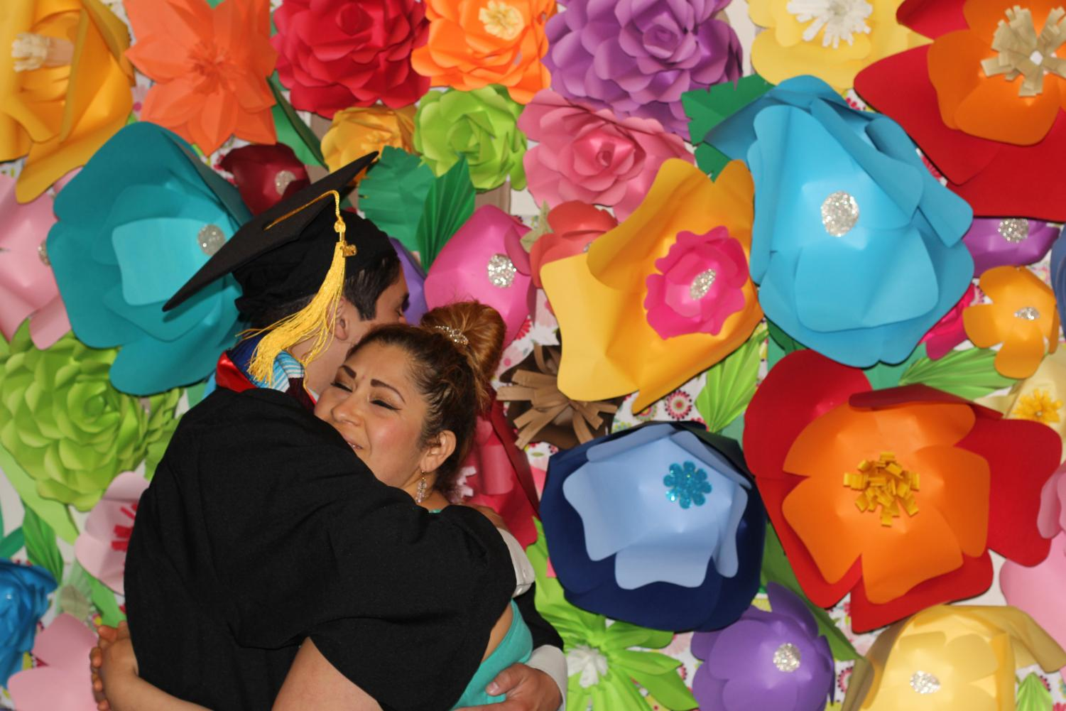 Bryan Josue Cruz hugs his mother, Rosa Maria Telles at his graduation earlier this month. By Brian Mohler