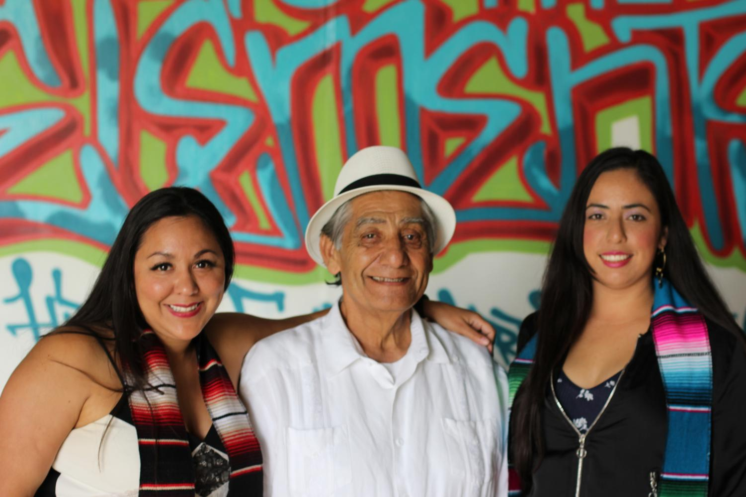 Professor Cruz Rangel pictured with students Mernis Gonzalez and Laura Marquez at the reception for the 49th Annual Chicano Latina Graduation Celebration held at the Centro Cultural de la Raza. By Brian Mohler/City Times