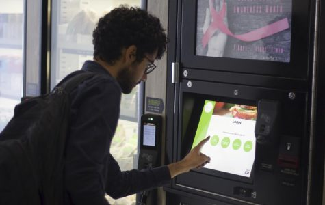 A City College student uses the Smart Market Vending machine.