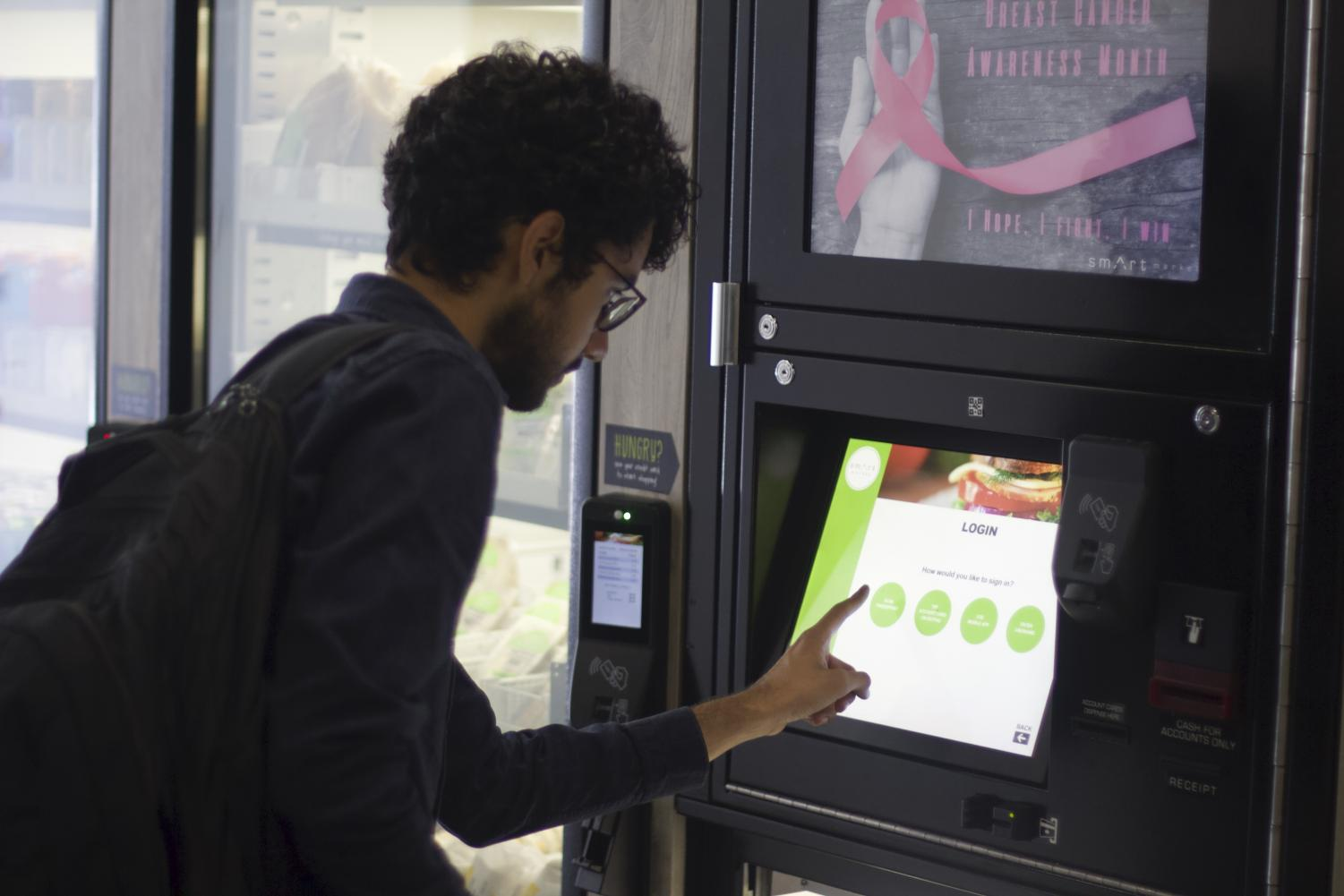 A San Diego City College student uses the Smart Market vending machine. Photo by Sonny Garibay