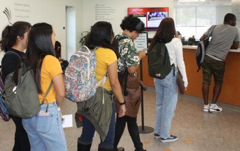 City College students wait in line in the financial aid office.
