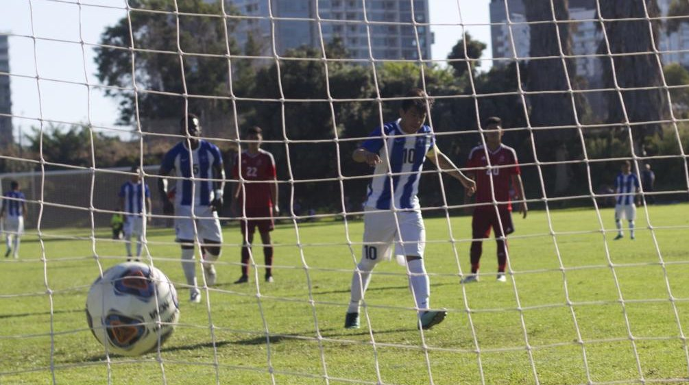 Cerritos College's Bryan Ortega (10) scores on a penalty kick against City College. Photo by Sonny Garibay