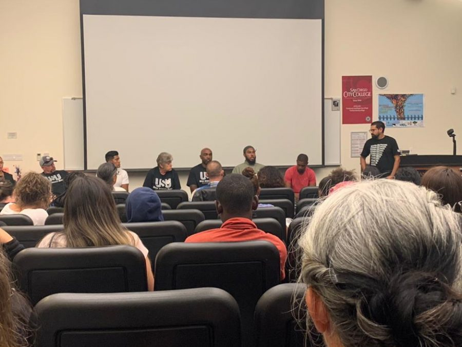 A panel of formerly incarcerated students speaks to am audience at City College.