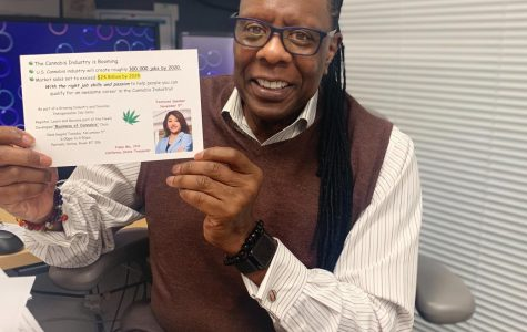 Dr. Leroy Brady holds up a flier for his new Business of Cannabis class.
