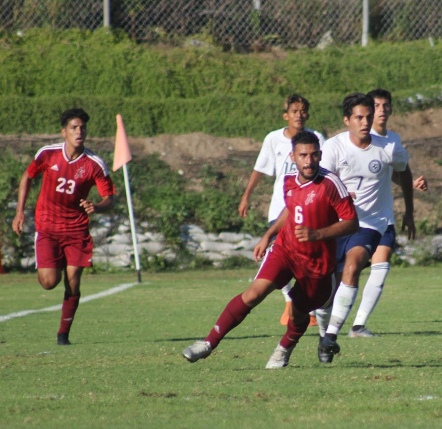 Knights players run up the soccer pitch against San Diego Mesa soccer players.