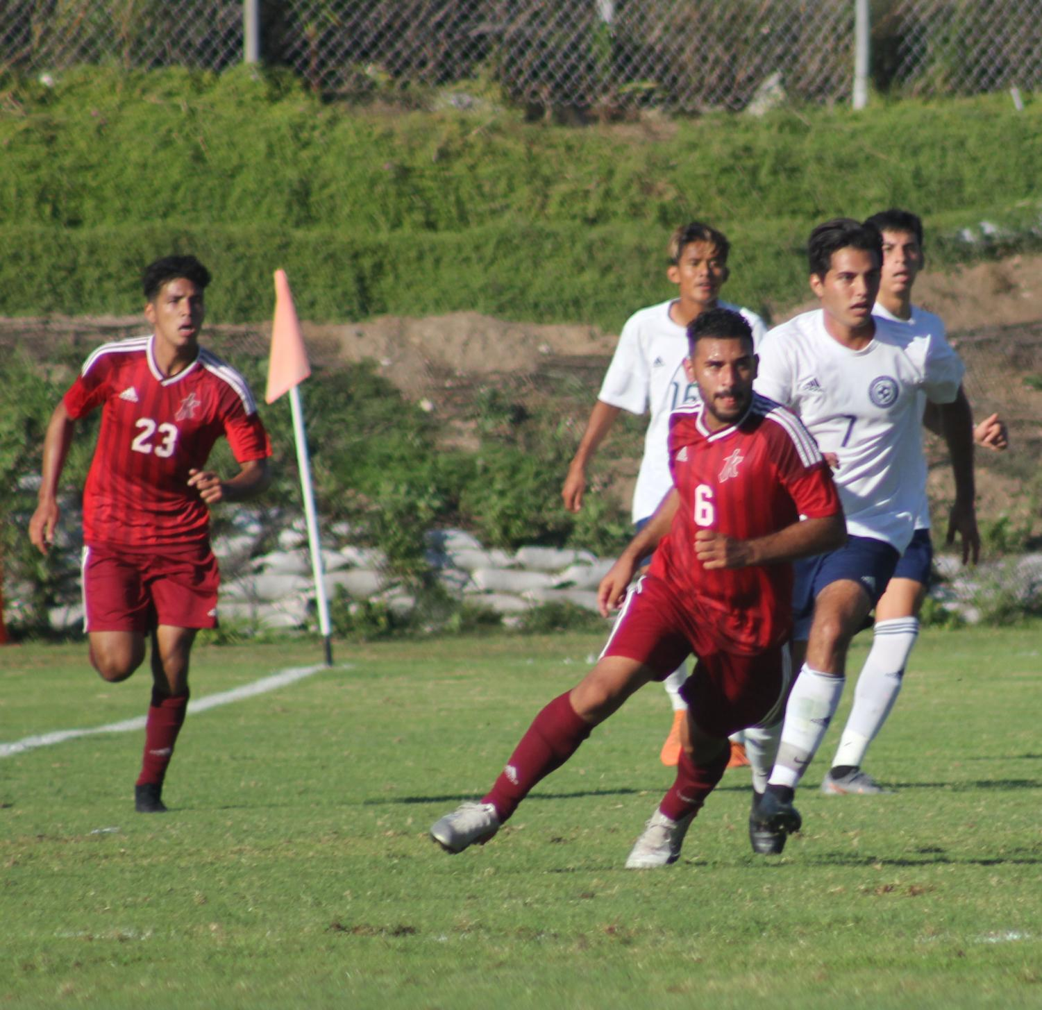 Christian Velasquez (6) and Jordy Robolledo (23) during a match against San Diego Mesa Oct. 8. Photo by Sonny Garibay